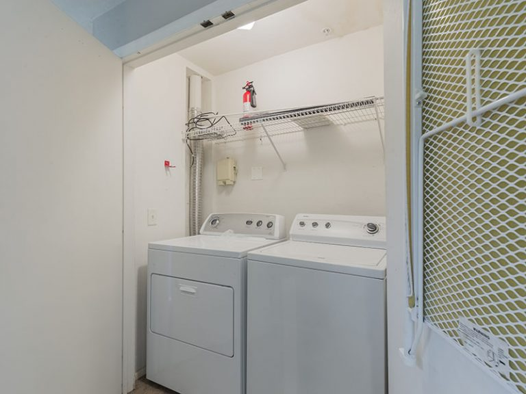 CountrySide at the University apartment interior, washer and dryer area